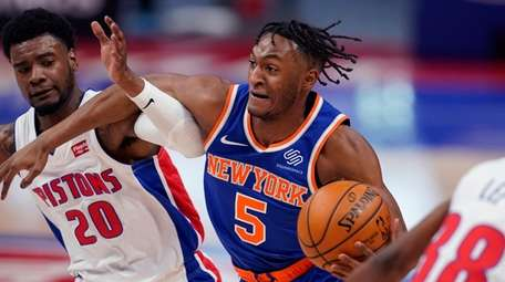 Knicks guard Immanuel Quickley (5) drives as Pistons