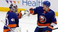 Semyon Varlamov and Mathew Barzal of the Islanders