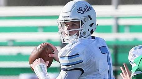 Oceanside's Charlie McKee looks to pass in the