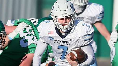 Oceanside's Charlie McKee runs the ball in the
