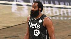 Nets guard James Harden walks on the court
