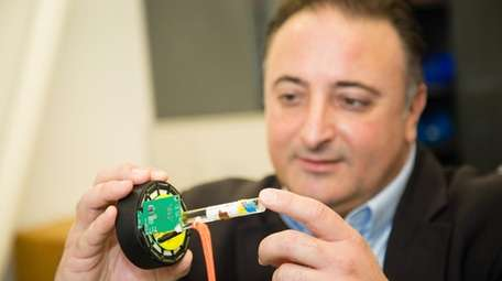 Marc Alessi, CEO of SynchroPET, shown holding the