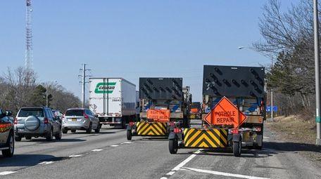 A truck rumbles by an LIE pothole repair