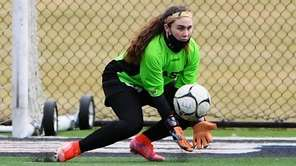 Smithtown East goalkeeper Talia Scheffer makes a save