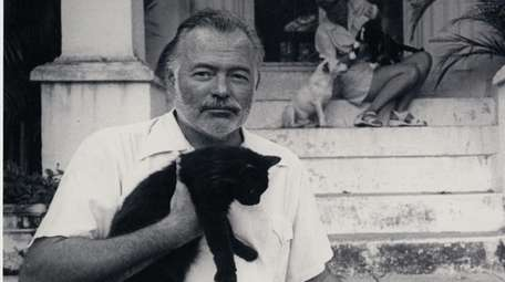 Ernest Hemingway at his home in Cuba, circa