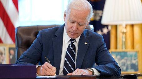 President Joe Biden signs the American Rescue Plan,