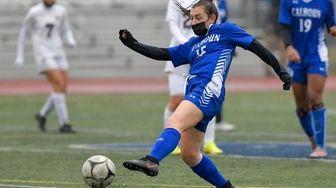 Olivia Perrone of Calhoun knocks the ball to