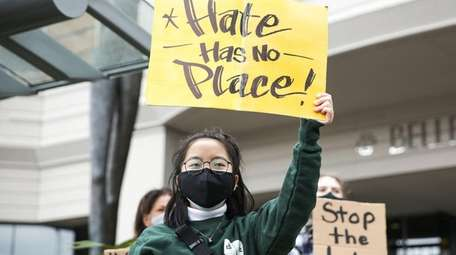 Demonstrators in Bellevue, Wash., on Thursday join nationwide