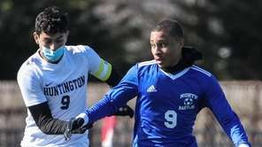 North Babylon's Orick Briscoe keeps the ball away