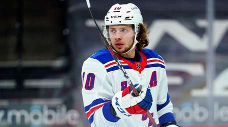 The Rangers' Artemi Panarin plays during an NHL