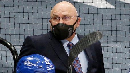 Islanders head coach Barry Trotz looks on against