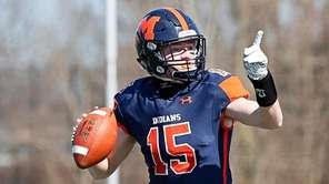 Rory Connor #15 of Manhasset runs the ball