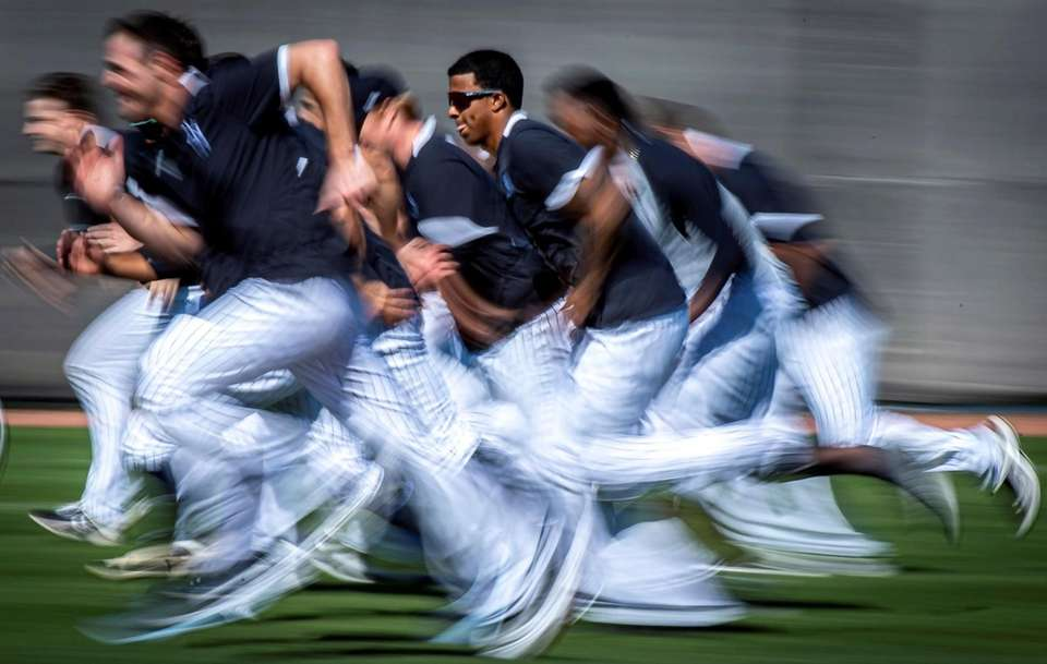 New York Yankees' pitchers run interval drills during