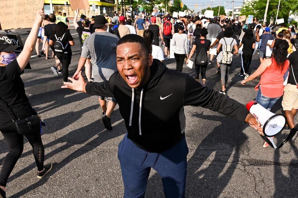 Jahshua Taylor, of Westbury (cq), shouts as protestors