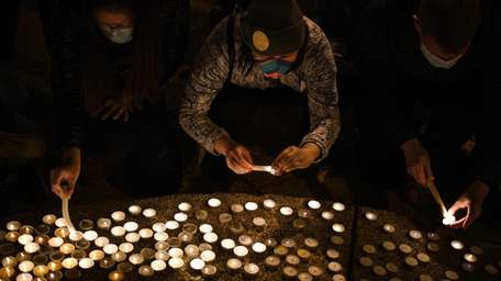 A candlelight vigil in Chinatown in Washington, D.C.,