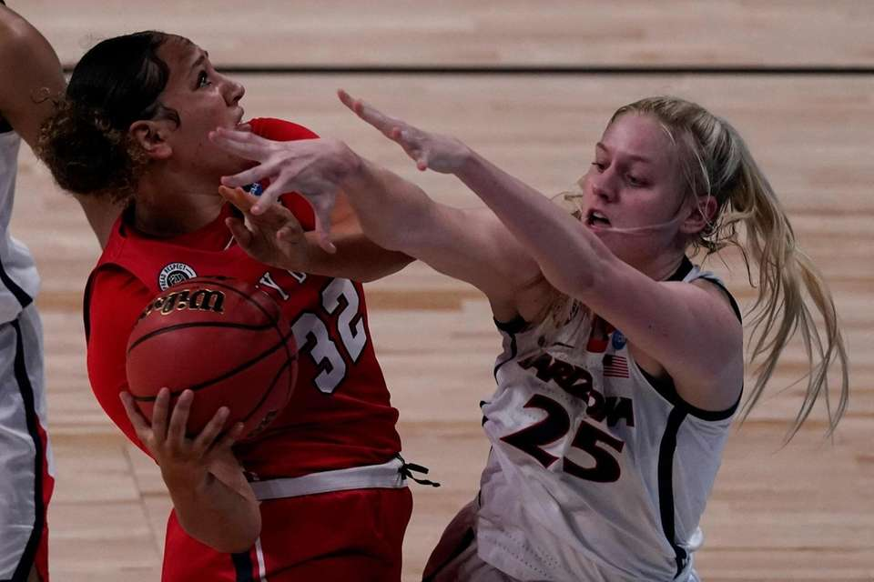 Arizona forward Cate Reese (25) tries to steal