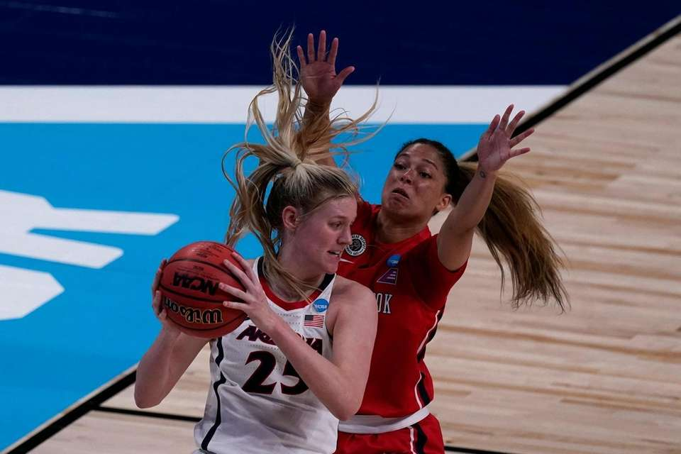 Arizona forward Cate Reese, front, is pressured by