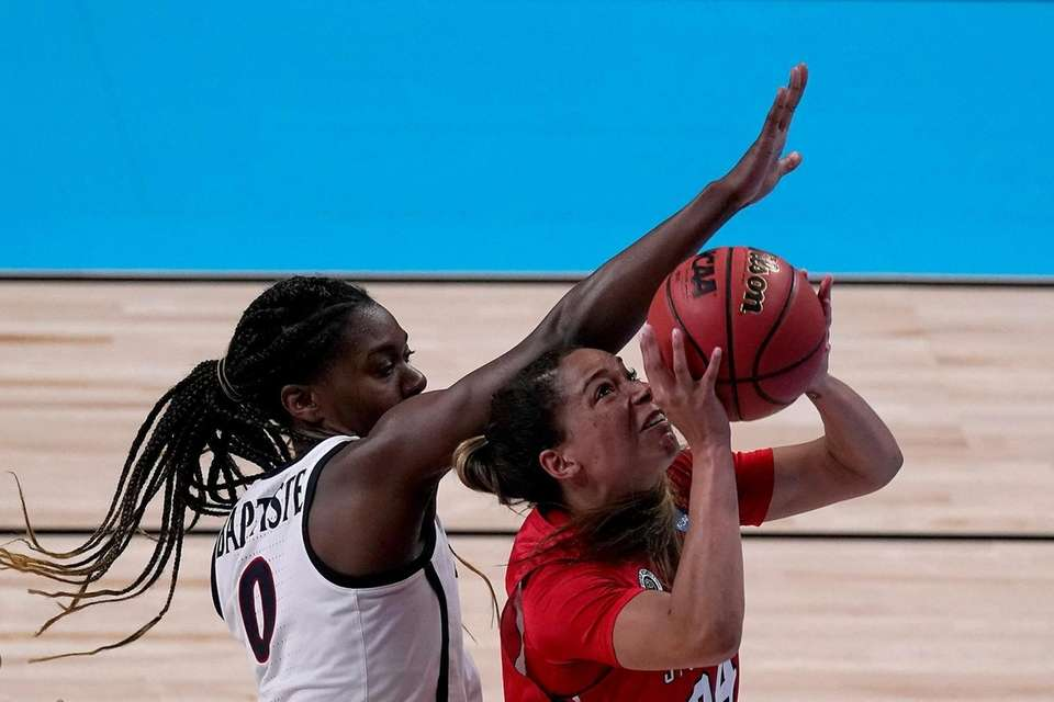 Stony Brook guard Hailey Zeise, right, shoots under