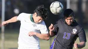Central Islip's Geovanni Donis (13) and Brentwood's Daniel
