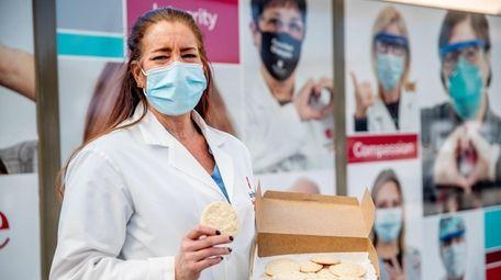 Nurse Debbie Del Giorno stands outside Stony Brook
