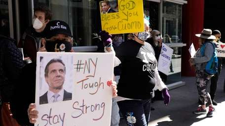 Gov. Cuomo's supporters rally in front of his