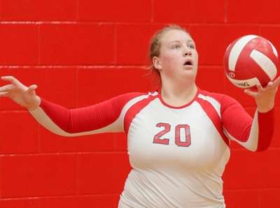 Sommer Madigan #20 of Smithtown East serves during