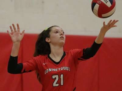 Connetquot's Gabriella Carere #21 serves the ball against