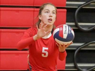 Katie Hickey #5 of Connetquot serves during a
