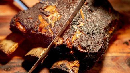 The massive beef rib at Smoked Barn in