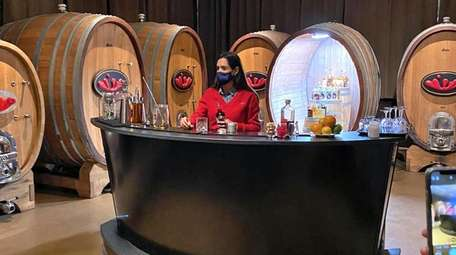 A masked bartender at Stoutridge Winery and Distillery
