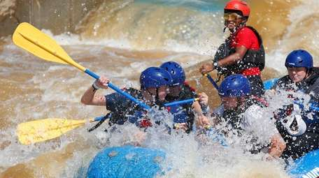 Try whitewater rafting during your spring adventure.