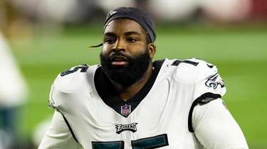 Eagles defensive end Vinny Curry walks off the