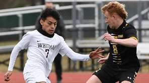 Whitman's Victor Vilorio Ortega is defended by Commack's
