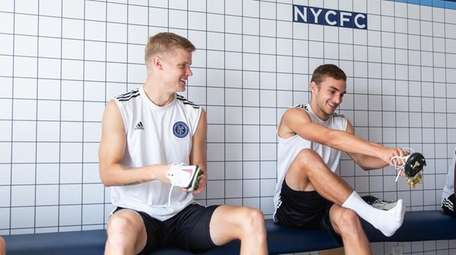 NYCFC midfielders Keaton Parks (left) and James Sands
