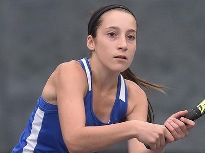 Ellie Ross of Port Washington returns a volley