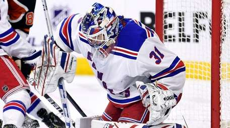 Rangers goaltender Igor Shesterkin makes a save as