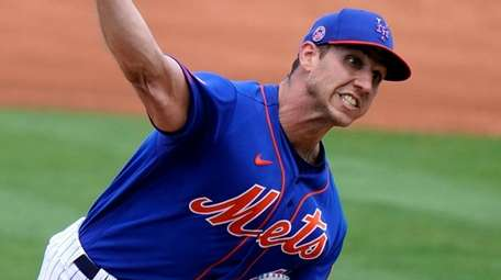 Mets starting pitcher Jacob Barnes throws during the