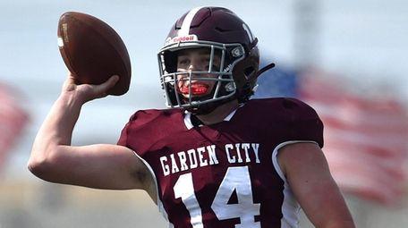 Luke Schmitt #14, Garden City quarterback, completes a