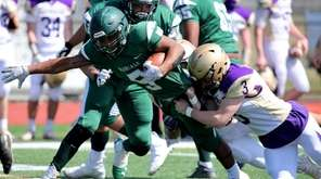 William Floyd RB Jezayd Hall lunges for a