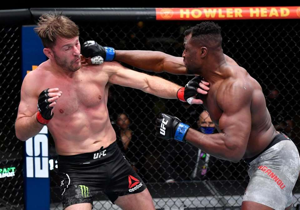 Francis Ngannou punches Stipe Miocic in their UFC
