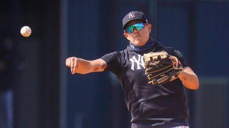 New York Yankees' Gio Urshela throws to first