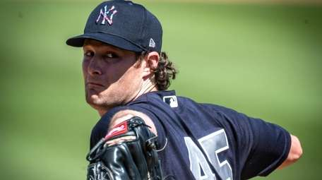 Yankees pitcher Gerrit Cole throws in the bottom