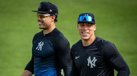 Yankees outfielders Aaron Judge, right, and Giancarlo Stanton