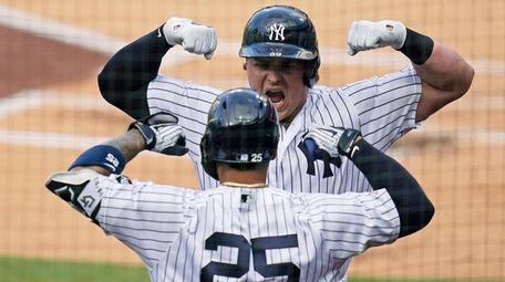 The Yankees' Luke Voit, right, celebrates with Gleyber