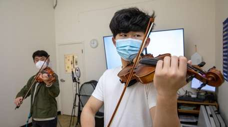 Musical Relief founders Michael Lan, 16, left, and