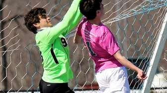 Westhampton Beach goalie Alessandro Volpe punches the ball