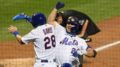 Mets designated hitter Pete Alonso celebrates his two-run