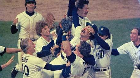 Detroit pitcher Willie Hernandez is mobbed by teammates