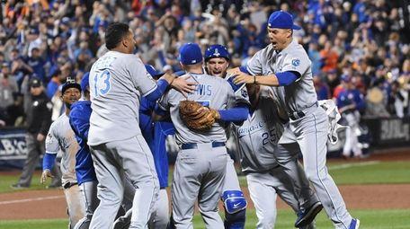 The Kansas City Royals celebrate  defeat the