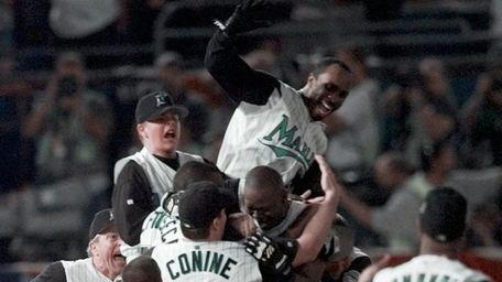The Florida Marlins mob teammate Edgar Renteria, whose